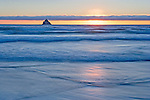 sunset and breaking waves at Arch Cape, Oregon Coast