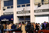 Hundreds of customers lined up on Tuesday, November 20, 1990 to reclaim their money after regulators closed Freedom National Bank in Harlem in New York. Once the fourth-largest black owned bank, the bank ventured into high-risk  loans with losses totaling $7 million since 1988.  (© Frances M. Roberts)