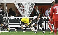 Troy Perkins #23 of D.C. United picks up a low ball during an MLS match against Toronto FC that was the final appearance of D.C. United's Jaime Moreno at RFK Stadium, in Washington D.C. on October 23, 2010. Toronto won 3-2.
