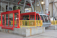 Passengers board a waiting tram in the newly renovated Roosevelt Island Tram station on Roosevelt Island.