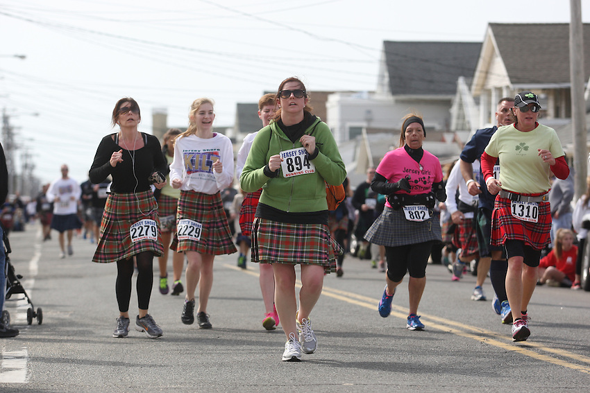 Jersey Shore Kilt Run photos: more than 3,000 try to break Guinness record for world&rsquo;s largest kilt race and raise money for Squan Strong, a Manasquan- based community group that helps raise money for Hurricane Sandy relief.<br /> <br /> In order to break the Guinness record for world&rsquo;s largest kilt race, he needed to sign up 2,000 participants, intrepid runners and walkers willing to trek 2 miles through Manasquan in wool skirts.