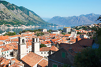 View across roof tops from the medieval  hill fortifications above Kotor across roof tops and Kotor Bay - Montenegro