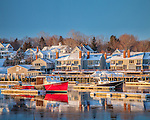 A red lobster boat in winter in Camden, ME, USA