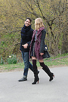 A fashion shoot in Central Park, Manhattan. The model's left shoe has nearly lost its heel, but the show must go on.<br /> New York, 2014