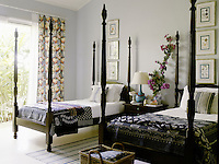 A seccond guest bedroom has a black and white colour scheme