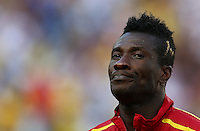 Asamoah Gyan of Ghana with blonde streaks died into the side of his hair