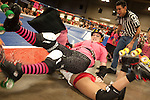 A penalty pillow fight is staged between Shanx-a-lot of Putas del Fuego and Smash-U-Delirious of Hellcats during their bout at Palmer Events Center in Austin, Texas.
