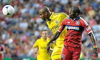 Columbus defender Julius James (26) heads the ball away from Chicago forward Dominic Oduro (8).  The Chicago Fire defeated the Columbus Crew 2-1 at Toyota Park in Bridgeview, IL on June 23, 2012.