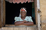A woman in the window of her home in Les Palmes, a rural village in southern Haiti where the Lutheran World Federation has been working with survivors of the 2010 earthquake, along with other residents, to experience more abundant life.