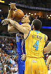 Apr 12, 2013; New Orleans, LA, USA; Los Angeles Clippers center Ryan Hollins (15) is defended under the basket bay New Orleans Hornets guard Xavier Henry (4) during the first half at the New Orleans Arena. Mandatory Credit: Crystal LoGiudice-USA TODAY Sports