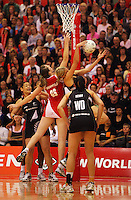 Casey Williams wins the ball from Louisa Brownfield during the New World International Netball Series between the NZ Silver Ferns and England at Arena Manawatu, Palmerston North, New Zealand on Wednesday, 18 October 2008. Photo: Dave Lintott / lintottphoto.co.nz
