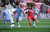 Chicago Fire forward Orr Barouch (15) shoots on Sporting KC goalkeeper Jimmy Nielsen (1).  The Chicago Fire defeated Sporting KC 3-2 at Toyota Park in Bridgeview, IL on March 27, 2011.