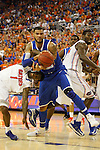 UK freshman forward Willie Cauley-Stein battles for the ball against UF senior guard Kenny Boynton during the first half of the University of Kentucky vs. University of Florida men's basketball game at the O'Connell Center in Gainesville, Fl., on Tuesday, February 12, 2013. UK lost 69-52. Photo by Tessa Lighty | Staff