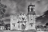 This is the historic Mission San José y San Miguel de Aguayo a Catholic in black and white mission.  This mission is located in San Antonio, Texas, United States. This is one of the many mission built back in the 1700s that have been well preserved and or still functioning as a church today. This historic landmark was a spanish mission community which was design to convert the indians of the area to the catholic religion. These missions are now part of the world heritage site, along with the San Antonio Missions National historic Park. These mission are visited by many tourist and they have become a travel destination for many who visit San Antonio. Watermark will not appear on image