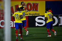 Ecuador's player Jefferson Montero ( Top) celebrates his goal with his teammates after scoring the third goal against Chile during their friendly match at the Citi-Field Stadium in New York, August 15, 2012. Photo by Eduardo Munoz Alvarez / VIEW.