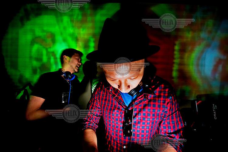 DJs play at the decks in a Hong Kong nightclub.