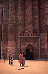 An Indian family gaze up at the historic Qutar Minar tower in New Delhi.