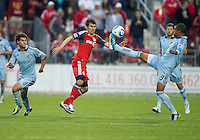 Sporting KC forward Teal Bunbury #9 and Toronto FC midfielder Nathan Sturges #11in action during an MLS game between Sporting Kansas City and the Toronto FC at BMO Field in Toronto on June 4, 2011..The game ended in a 0-0 draw...
