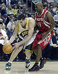 Seattle SuperSonics'  Nick Collison (L) grabs a loose ball in front of Houston Rockets'  Mike James during the second period of their game at Key Arena in Seattle, Washington Monday, 11 April 2005.  Jim Bryant Photo. &copy;2010. All Rights Reserved.