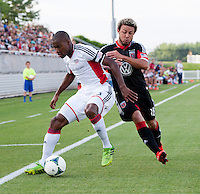 Nick DeLeon (18) of D.C. United fights for the ball with Jose Goncalves (23) of the New England Revolution during the quarterfinals of the US Open Cup at the Maryland SoccerPlex in Boyds, Md.  D.C. United defeated the New England Revolution, 3-1.