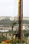 General picture taken from the Palestinian side of the southern Gaza Strip town of Rafah shows heavy machinery are installing underground metal sheets at work on the Egyptian side of the border on December 31, 2009.. Photo by Abed Rahim Khatib
