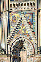 Close up of a gable with mosaics depicting the batism of Christ by John the Baptist created between 1350 and 1390 after designs by artist Cesare Nebbia on the14th century Tuscan Gothic style facade of the Cathedral of Orvieto, designed by Maitani, Umbria, Italy