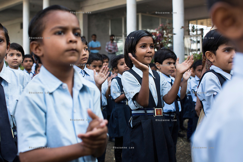 Anjali Kanel (right), aged 6, lines up with other students for morning assembly in the Vasudha Vidya Vihar school in Khargone, Madhya Pradesh, India on 12 November 2014. Anjali is the daughter of a Fairtrade cotton farmer and her ambition is to be a Computer Engineer.