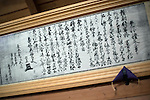 Photo shows a framed copy of the permit that allowed matagi hunter Sadaroku to hunt anywhere in Japan inside Roken Jinja, a shrine in Odate City, Akita Prefecture Japan. Sadaroku's dog, an Akita Inu named Shiro, tried to rescue his master after her was caught hunting with out his permit and faced execution. Photographer: Rob Gilhooly