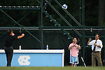 07 September 2007: Texas head coach G. Guerrieri (l) tosses a soccer ball to UNC head coach Anson Dorrance (r). The University of North Carolina Tar Heels defeated the Texas A&M University Aggies 2-1 at Fetzer Field in Chapel Hill, North Carolina in an NCAA Division I Women's Soccer game, and part of the annual Nike Carolina Classic tournament.