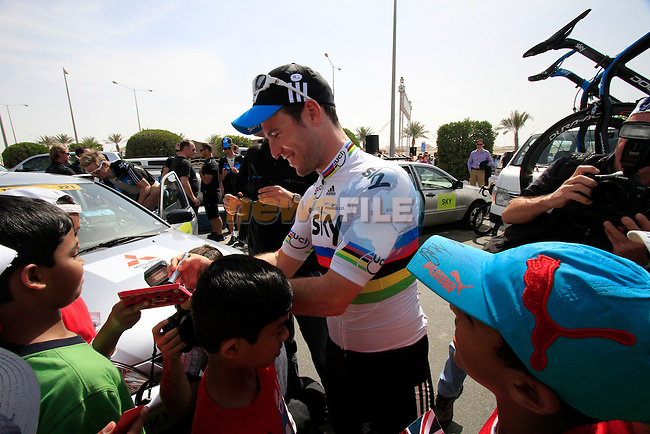 Sky Procycling rider World Champion Mark Cavendish (GBR) signs autographs for local school children before the start of the 3rd Stage of the 2012 Tour of Qatar outside Dukhan Souq, Dukhan, Qatar, 7th February 2012 (Photo Eoin Clarke/Newsfile)