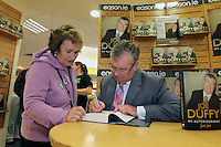 NO FEE PICTURES.15/10/11 Eason, Ireland's leading retailer of books, stationery, magazines and lots more, hosted a book signing by RTE presenter, Joe Duffy. Pictured at Eason,O'Connell Street, Dublin is Joe Duffy who signed copies of his new autobiography Just Joe..Follow Eason on Twitter @easons. Pictured with Joe Duffy is Margaret Mooney, Rathfarnham. Pictures:Arthur Carron/Collins