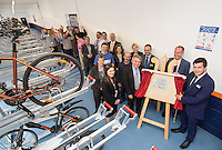 Robert Goodwill MP, Minister of State for Transport (centre), pictured with Johnny Wiseman of East Midlands Trains (right) at the unveiling of Nottingham Railway Station's new secure Cycle Hub
