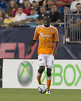 Houston Dynamo midfielder Je-Vaughn Watson (10) at midfield. In a Major League Soccer (MLS) match, the New England Revolution tied Houston Dynamo, 1-1, at Gillette Stadium on August 17, 2011.