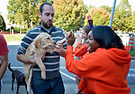 Participants, including this man and his dog, are greeted by cheerleaders from a local high school as they finish the CROP Hunger Walk in Raleigh, North Carolina, on October 27, 2013.