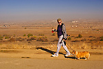 Woman walking her dog on the bluffs at Panorama Park, Bakersfield, California.