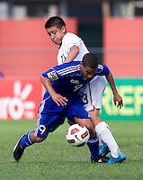 Dillon Serna (13) of the United States tries to take the ball away from Dairon Perez (9) of Cuba during the first day of the group stage at the CONCACAF Men's Under 17 Championship at Catherine Hall Stadium in Montego Bay, Jamaica. The United States defeated Cuba, 3-1.