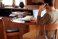 Tias Little works on his laptop