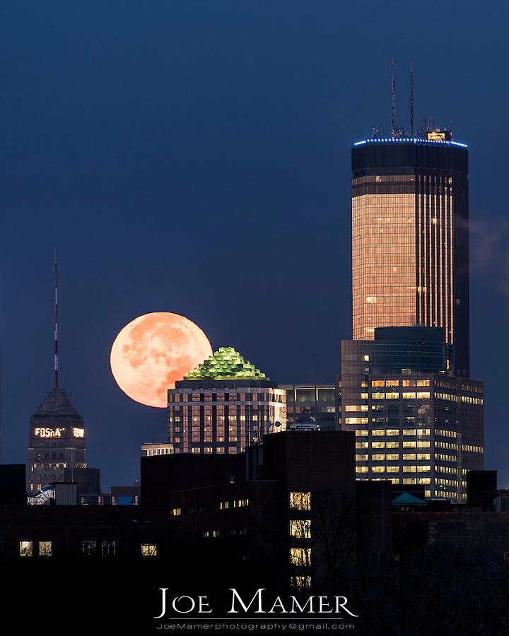 November 2016 super moon sets behind downtown Minneapolis.