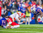 9 November 2014: Kansas City Chiefs quarterback Alex Smith gains a yard on a keeper play before being stopped by Buffalo Bills free safety Aaron Williams (23) and Bills outside linebacker Nigel Bradham (53) during the third quarter at Ralph Wilson Stadium in Orchard Park, NY. The Chiefs rallied with two fourth quarter touchdowns to defeat the Bills 17-13. Mandatory Credit: Ed Wolfstein Photo *** RAW (NEF) Image File Available ***