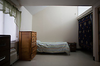 A view of bedrooms in the residences in Malone Park at the Fernald Developmental Center in Waltham, Massachusetts, USA.  Many of the residents cannot share a room with others.