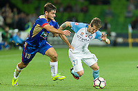 Melbourne, 10 November 2016 - FERNANDO BRANDAN (27) of Melbourne City and IVAN VUJICA (13) of the Jets fight for the ball in the round 6 match of the A-League between Melbourne City and Newcastle Jets at AAMI Park, Melbourne, Australia. Melbourne won 2-1 (Photo Sydney Low / sydlow.com)