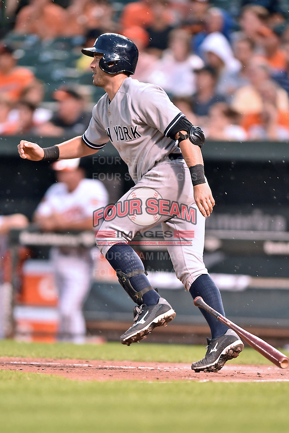 New York Yankees catcher Francisco Cervelli #29 swings at a pitch during a game against the Baltimore Orioles at Oriole Park at Camden Yards August 11, 2014 in Baltimore, Maryland. The Orioles defeated the Yankees 11-3. (Tony Farlow/Four Seam Images)