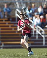 Harvard University midfielder Audrey Todd (21) on the attack.