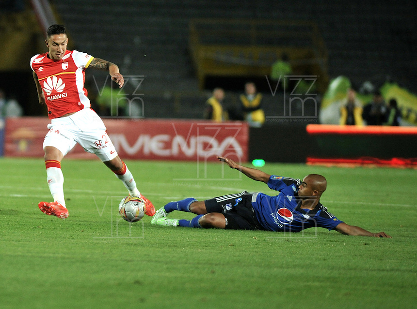 BOGOTA - COLOMBIA -14 -03-2015: Lewis Ochoa (Der.) jugador de Millonarios disputa el balón con Dairon Mosquera (Der.) jugador de Independiente Santa Fe, durante partido entre Millonarios e Independiente Santa Fe por la fecha 10 de la Liga Aguila I-2015, jugado en el estadio Nemesio Camacho El Campin de la ciudad de Bogota. / Lewis Ochoa (R) player of Millonarios vies for the ball with Dairon Mosquera (L) player of Independiente Santa Fe, during a match between Millonarios and Independiente Santa Fe, for the  date 10 of the Liga Aguila I-2015 at the Nemesio Camacho El Campin Stadium in Bogota city, Photo: VizzorImage / Luis Ramirez / Staff.
