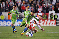 Fredy Montero (17) of the Seattle Sounders gets past the tackle of Teemu Tainio (2) of the New York Red Bulls during the second half. The New York Red Bulls defeated the Seattle Sounders 1-0 during a Major League Soccer (MLS) match at Red Bull Arena in Harrison, NJ, on March 19, 2011.