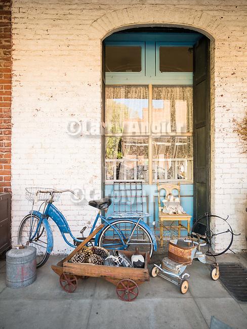 Antique shop window, summer evening Amador City, Calif.