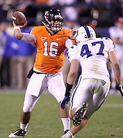 CHARLOTTESVILLE, VA- NOVEMBER 12:  Quarterback Michael Rocco #16 of the Virginia Cavaliers gets pressure from linebacker David Helton #47 of the Duke Blue Devils during the game on November 12, 2011 at Scott Stadium in Charlottesville, Virginia. Virginia defeated Duke 31-21. (Photo by Andrew Shurtleff/Getty Images) *** Local Caption *** Michael Rocco;David Helton