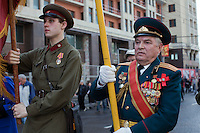 Moscow, Russia, 01/05/2010..An army veteran and a young man in Soviet era army uniform demonstrate in central Moscow. A variety of political groups took to the streets on the traditional Russian Mayday holiday.