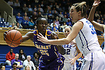19 December 2013: Albany's Shereesha Richards (25) and Duke's Haley Peters (33). The Duke University Blue Devils played the University at Albany, The State University of New York Great Danes at Cameron Indoor Stadium in Durham, North Carolina in a 2013-14 NCAA Division I Women's Basketball game. Duke won the game 80-51.