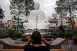 "People pray to a statue of ""Phat Thich Ca Mau Ni"" or ""Sakyamuni Buddha"" at the Giac Lam Pagoda in Tan Binh District in Ho Chi Minh City, Vietnam. Photo taken Tuesday, May 4, 2010....Kevin German / LUCEO"